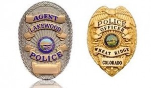 The Wheat Ridge and Lakewood police department badges.
