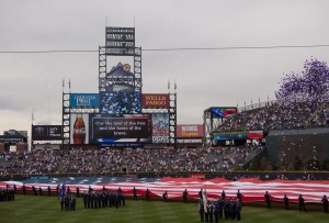The National Anthem is played while the U.S. Military unfolds the American flag. Photo by Ashley Hattle.