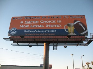 SIGN OF THE TIMES: The pro-marijuana billboard that was hung near Sports Authority Field. (Photo by Laurence Washington)