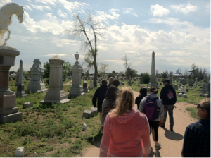 MSU Denver's Hospitality, Tourism and Events students forge ahead with their preservation efforts of Denver's Riverside Cemetery. Photo Credit: Helle Sorensen