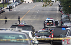 Barricade tape continues to be unraveled on Capitol Hill.  The police vehicle that hit a barricade waits while police close the streets.  Photo by Ashley Hattle