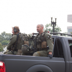 FBI officials drive down Constitution St. near the Capitol building where the streets have been closed for the duration of the investigation.  [Photo by Ashley Hattle]