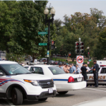 Police cars line the streets after an unauthorized vehicle broke through police barricades at the White House and the Capitol building.  [Photo by Ashley Hattle]