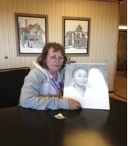 Betty Jackson holding a sketch she had just finished in an hour.