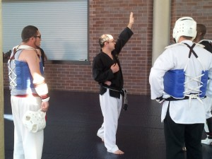 6th dan black belt, Bill Pottle ( Black Shirt) provides Auraria campus students with the opportunity to register for Taekwondo and receive two course credits.