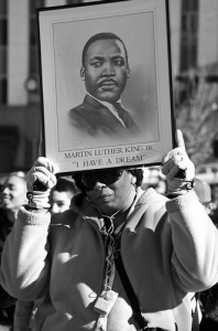 "A participant in Denver's 2014 Martin Luther King Marade holds a picture of King, saying ""I have a dream,"" on Jan. 20.   Photo by Melanie J. Rice • mrice20@msudenver.edu"