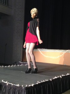 Drag Queen poses as she performs on the stage.