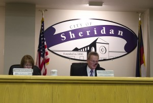 (L-R) Tara Beiter-Fluhr reviews a bill as Mayor, Dallas Hall introduces it to the Sheridan City Council on March 10.  Photo by Melanie J. Rice • mrice20@msudenver.edu