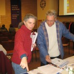 Pat Blumenthal of ACLU-Colorado directs a member to literature. Photo by Angela Jackson