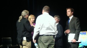 """9-KUSA's Kyle Clark joins panel members in greeting audience members following Wednesday night's """"Sunshine Week"""" meeting. [Photo by: Tommy Trask]"""
