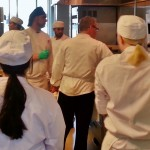 Tricks of the Trade: Students enrolled in Food Production and Service II gather around Chef Beckwith and learns together as a team. (Photograph taken by Daniel Day)