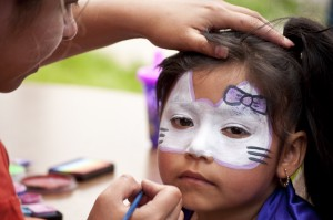 Citlali Trejo paints 5-year-old Edna Juarez's face at the Westwood Summer Fiesta on May 21.  Photo by Melanie J. Rice • mrice20@msudenver.edu