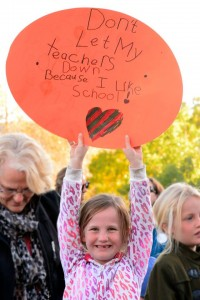 6-year old Aubrey Magid attended the meeting to stand up for her teachers. This issue is important to her because she likes school. [Photo by Rochelle Ball]