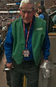 Pepsi Center Employee, George Heath gets ready to walk down the aisles to get peoples recyclables. (Photo by John McMinn)