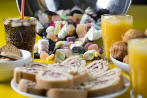 Sugary drinks, candies and sweets. (Photo By WHO /Christopher Black)