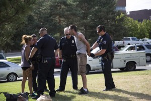 Auraria Campus Police made an arrest Aug. 12, 2015, after finding an outstanding warrent. They were led to the man and woman by another man who was reportedly drunk and stopping traffic on Colfax Avenue. Photo by Sara Hertwig