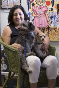 Canine Companionship Newly retired MSU Denver professor Oneida Meranto, Ph.D., sits with her dogs Danny and Frida in her charity-shop that opened in July. Photo by Daniel Day