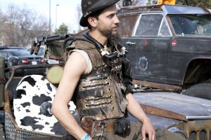 Clay Kuehn dresses up as a wasteland warrior standing next to his custom-made vehicle, March 12, 2016, at Denver's StarFest. Photo by Kavann Tok