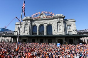 SEA OF ORANGE: Denver Broncos Super Bowl 50 victory parade through downtown Denver on Feb. 9, 2016. [Photo: Ben Hays]