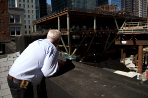 Gasser overlooks the railway construction behind his store on Second Street. The Adolph Gasser Photography store will be forced to close as the building continues to push East through the city. [Photo: Sarah Courtney]